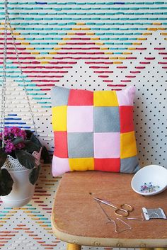 What a great idea for your craft room or office -- peg board wall with yarn!