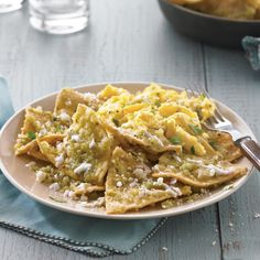 In this chilaquiles verdes recipe, crisp corn tortilla wedges are simmered in a mild tomatillo salsa, creating a rich, savory base for scrambled eggs. Mexican Dishes, Mexican Food Recipes, Ethnic Recipes, Dinner Recipes, Mexican Breakfast Recipes, Savory Breakfast, Breakfast Ideas, How To Make Chilaquiles, Chilaquiles With Eggs