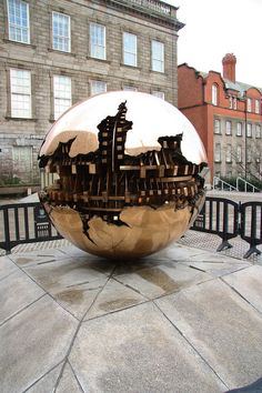Sphere within a sphere Sculpture by Arnaldo Pomodoro in Trinity College