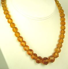 30% off #sale until 11/23/15 A very lovely piece of #jewelry made with #faceted amber glass beads that are graduated in size moving toward the center or middle of the necklace. This necklace features bea... #beads #judysgems2 #vintage #necklace #teamlove #present
