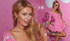 Paris Hilton is a real life Barbie girl in baby pink Moschino dress