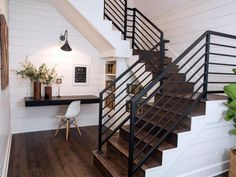A work desk and integrated bookshelves are tucked neatly under the newly reconfigured stairs.