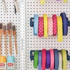 Loecke transformed a paper towel holder into a ribbon dispenser. A screwdriver rack holds paintbrushes. - FamilyCircle.com