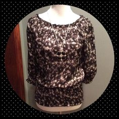 INC Silk Blouse 100% silk black and white blouse. Has an elastic banded bottom, as well as on 3/4 sleeves. Only worn twice, excellent condition. No trades. INC International Concepts Tops Blouses
