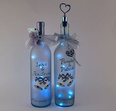 Light Bottles by Vicki. Hand painted wine bottles :) they are gorgeous and the perfect gift for any loving couple     http://www.etsy.com/shop/LightBottlesByVicki