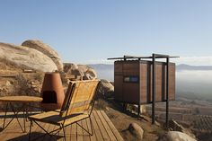 Endemico's sustainable structures have an outdoor terrace with a sitting area and a kiva.
