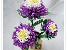Nice flowers from beads You will need:  green beads white beads yellow beads purple beads  (All the beads No. 10)  copper wire - diameter of 1mm wire of colors: purple, green , yellow , steel - 0.3mm diameter Floral tape - green
