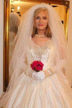 Crossdressing bride dressed for her special day wearing a silk wedding dress, perfectly turned out on her crossdressing makeover