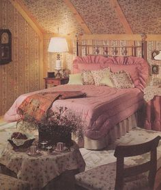 The room has the mauve color to it, with ruffle pillows, and a floral pattern.