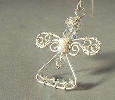 White angel handmade wire wrapped pendant or Christmas ornament silver filled white transparent beaded