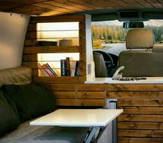 Wonder if there's enough room between the bed and front seats to build shelves and a divider?