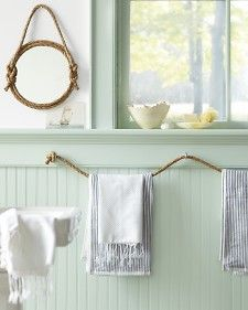 Rope towel hangers. Saw it in Martha Stewart, but cool to pin.
