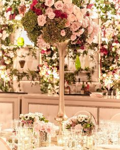 Floral Arrangement on Tall Gold Stand | Photo: Gloria Mesa Photography.