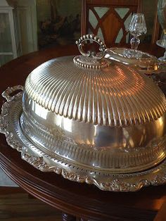 """This is a silver-plated hotel turkey platter and dome. It is absolutely huge, measuring long x wide. It takes some muscle to lift it! It has a crest engraved on the front and the scalloped tray is substantial.""(Southern Chateau: A Thing of Beauty)"