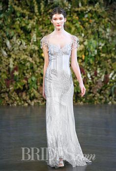 "Brides.com: . ""Florence"" Guipure lace sheath wedding dress with with French lace details, a sweetheart neckline, and fringed cap sleeves, Claire Pettibone"