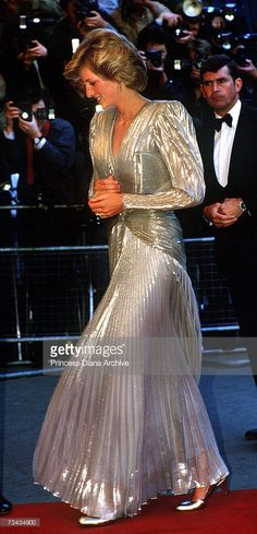 Princess Diana (1961 - 1997) arrives for the London premiere of the James Bond film 'A View To A Kill' at the Empire, Leicester Square, July 1985. She is wearing a gold lame evening gown by Bruce Oldfield.