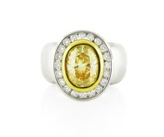 An White and Yellow Gold, Fancy Yellow Oval Cut Diamond Halo Ring Yellow Diamond Rings, Halo Diamond, Diamond Dress, Dress Rings, Halo Rings, Vintage Rings, Jewelry Collection, White Gold, Fancy