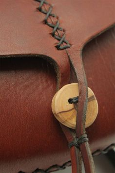 Items similar to small leather bag. wren in cherry wood red vegetable tanned leather. wood button on Etsy small leather bag. artisan by underthetreeithaca Small Leather Bag, Leather Art, Sewing Leather, Leather Books, Leather Pattern, Leather Gifts, Leather Pouch, Leather Design, Leather Tooling