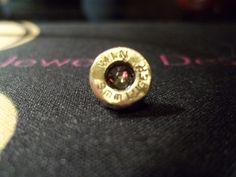 Bullet casing Tie/Lapel pi with Smokey Black Swarovski crystal. $20.00.