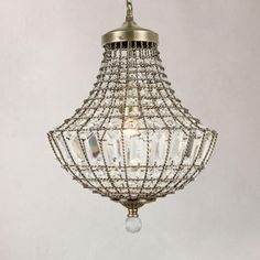 Featuring a metal chain design in an antique brass finish, this hanging ceiling fitting is decorated with intricately cut crystal glass embellishments. This light only requires 1 bulb. Antique Brass Chandelier, Metal Chain, Bulb, Ceiling Lights, Contemporary, Crystals, Pendant, Antiques, Glass