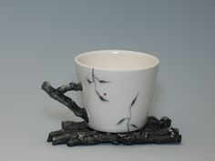 "Mindy Andrews. Twig Cup and Saucer, Slip cast porcelain, Cone 6, Velvet underglaze, hand painted, 4.5x""2.75""x2.5"". $65"