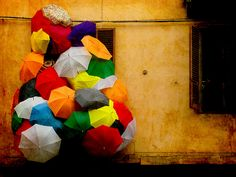 colorful umbrellas in grey monsoons =)