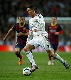 Cristiano Ronaldo in action during the La Liga match between Real Madrid CF and FC Barcelona at Estadio Santiago Bernabéu on March 23, 2014 in Madrid, Spain.