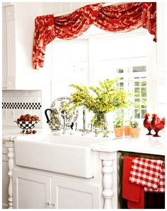 Kitchen Window - we have a hideous stenciled thingy between the cabinets in front of the window.  i worry about removing it because it will leave very noticeable damage to the cabinets.  maybe i'll just cover it, something similar to this...