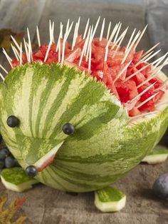 How perfect-- the serving toothpicks become part of the art! Watermelon Hedgehog