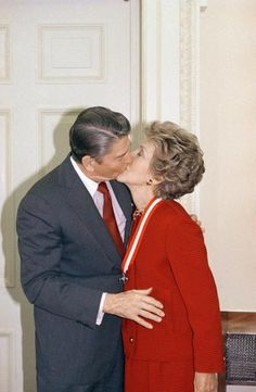 President Ronald Reagan and First Lady Nancy Reagan share a kiss