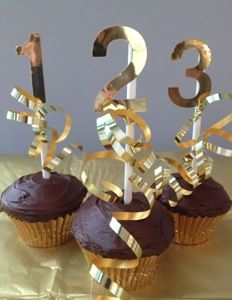 New Year's Cupcakes - Attach gold or silver vinyl numbers (available at Staples or Office Max) to a toothpick or lollipop stick and insert into iced cupcakes. Complete the look with matching metallic cupcake liners and arrange the cupcakes in numerical order on a platter