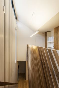 baker residence - stair-timber battens form the balustrade and upstairs the back of a home office.  By designmas