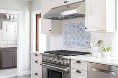 Blue kitchen backsplash and Wolf oven | Blue Ridge Boeing Castle Taken to New Heights by Model Remodel, Seattle, WA  Specs: - Ann Sacks backsplash - Wolf stove - Bosch dishwasher
