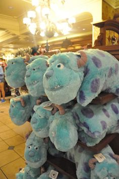 """Looking to scare up some fun this summer? Mike Wazowski, a monster who takes his scaring seriously, and James P. Sullivan (otherwise known as """"Sulley""""), a nat Disney Pillow Pets, Mike Wazowski, Monster University, Animal Pillows, Disney Parks, Disney Movies, Some Fun, Monsters, Dinosaur Stuffed Animal"""