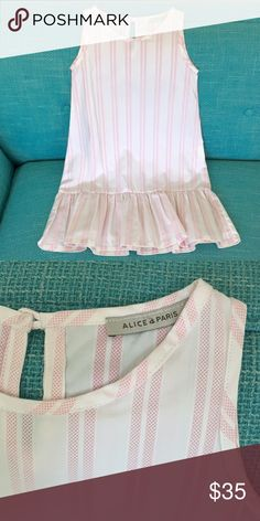 "🇫🇷Parisian dress🇫🇷 Gorgeous girls dress from Paris. White with light pink stripes. Drop waist with ruffle. Size says 36 months but runs large. Length from top of shoulder to bottom of hem is 24"". Width across under arm hole is 12.5"". In PERFECT condition! Gorgeous and purchased at the Alice a Paris boutique in St Germain neighborhood of Paris. Alice a Paris Dresses"