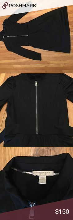 Burberry Brit Dress Size XS Burberry Brit Dress. Has a collar and a zipper on the front. Also has an attached wraparound belt and ruffles on the sleeves Burberry Dresses