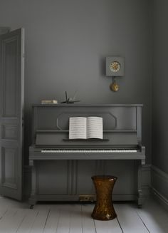 this is a cool look - piano painted monochrome with the wall so it's the textures that stand out