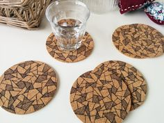 These coasters are handmade by me in my home in Eindhoven, the Netherlands. The coasters are made of cork and I drew the triangle print on them by
