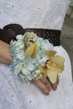 Love these colors for a corsage (Gold and pale blue color scheme)