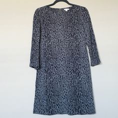 Grey Gap animal print dress Grey and charcoal animal print dress. Gap, size 2. Zipper in back. Minor wear. Small (approx. 1 inch) area with fabric/thread defect on right sleeve - see far left on third photo. Cute, comfortable, and easy outfit for all seasons. GAP Dresses
