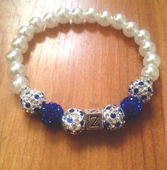 This stretch bracelet is a special piece inspired by Zeta Phi Beta Sorority, Inc.   For every Zeta bracelet sold, 20% of every order will go to