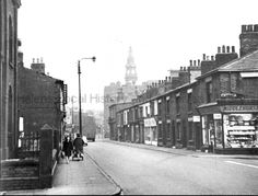 MCL/3/126 Black and white photograph showing the corner of Westfield Street and Thomas Street, St.Helens 1965. Beecham's Tower can be seen in the distance. MCL - Clare Collection 3 - Black and white photographs and drawings of St.Helens.