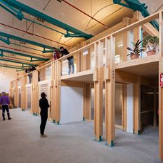"""The group built a facility called Coòpolis that offers spaces for the training and support of other groups striving for a """"cooperative economy"""" in the Catalan capital. Spanish Architecture, Dezeen, Building, Projects, Collection, Home Decor, Zero, Training, Restaurant"""