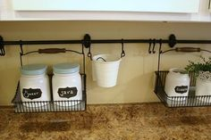 The newly uncluttered kitchen counter - using IKEA Fintorp series wall rack rods and hanging wire baskets Unclutter, Uncluttered Kitchen, Kitchen Counter, Space Saving Kitchen, Counter Clutter, Organization Hacks, Kitchen Counter Organization, Diy Kitchen, Primitive Kitchen