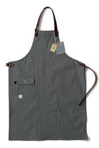 """The Mercantile is inspired by the aprons worn by both men and women in Grocery and Dry Goods stores up until the 1950's to protect clothing during the working day. This style has a 2 way pocket. The apron measures:31"""" wide 39"""" lengthThis apron made to order which usually takes around a week. Its details include metal buckles, saddlery leather. Dawson branded die set buttons, unbranded copper rivets. Hemmed on our 1959 union special 42300g. All our aprons are numbered.The Fabric :12 oz indigo…"""