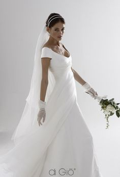 I like the flowyness of this dress... maybe put a lighter version of my color on top? don't need the shawl thing that is around the model's hands spose di gio wedding dress.