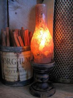 DIY Lantern:  chunky candle holder made grubby, lantern globe and battery operated flicker candle...