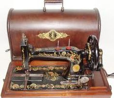 singer - my grandmother Lini had one just like this - beautiful.   I wonder what happened to it.
