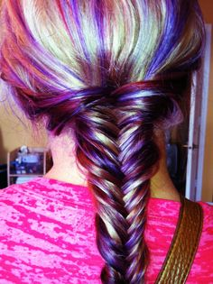 Colorful hair. Blonde haircolor with toffee, red and purple lowlights styled into a fishtail braid. - Northern Highlights
