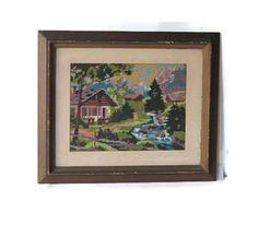 Vintage framed landscape embroidery. Cross stitch. Green blue white with dark brown frame.